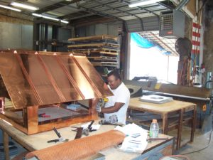 Happy Worker at Stuart's Sheet Metal Fabricating Custom Steel Job